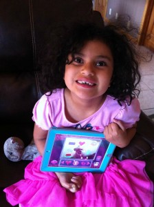 """My daughter playing with the new Disney Doc Mcstuffins App.  That's her """"Lambie"""" next to her."""