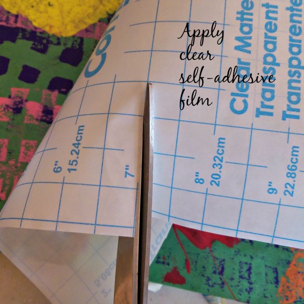 Apply clear self-adhesive film