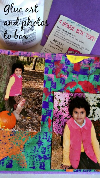 Glue art and photos to box