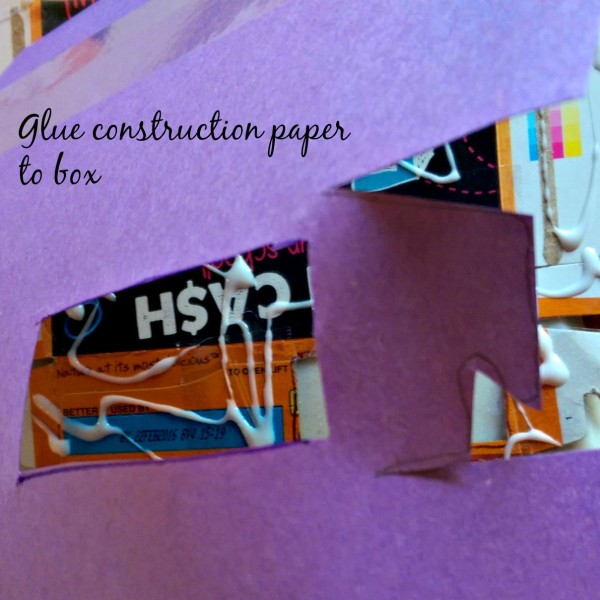 Glue construction paper to box