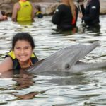 maya smile with dolphin